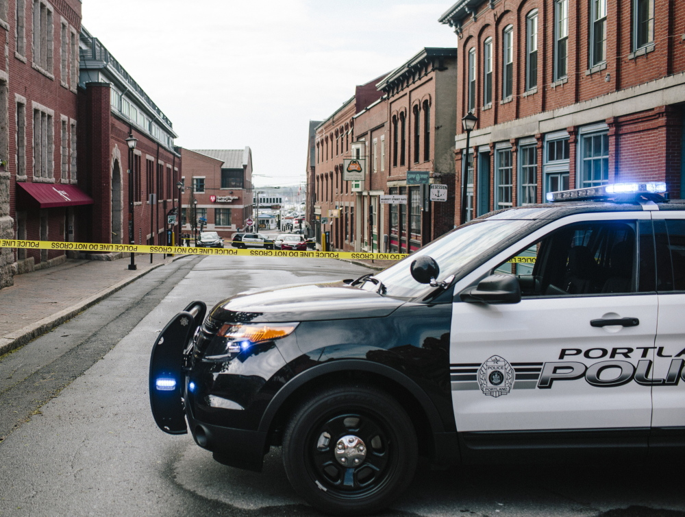 A section of Market Street in Portland is closed off with crime scene tape Tuesday after a fatal shooting late Monday in an Old Port recording studio. Violent crimes draw a great deal of attention in Maine – the safest state in a country experiencing one of the most prolonged downswings in crime in its history.