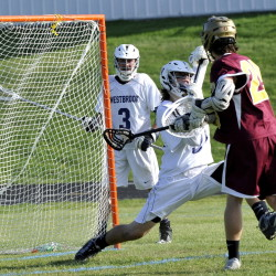 Justin Masteller of Thornton Academy gets the ball past Westbrook goalkeeper Alex Leblanc during their boys' lacrosse game Wednesday at Westbrook High. Thornton used four goals in a three-minute span to come away with a 14-10 victory.