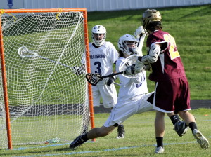 Jon Camire of Thornton Academy gets the ball past Westbrook goalkeeper Alex Leblanc during their boys' lacrosse game Wednesday at Westbrook High. Thornton used four goals in a three-minute span to come away with a 14-10 victory.