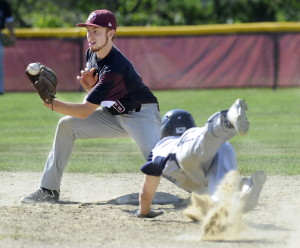 Ben Humphrey of Freeport takes the throw from the catcher and prepares to slap on a tag in time to get Jack Snyder of Yarmouth, who was attempting to steal second base.