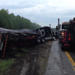 No injuries resulted from a storm-related collision between a car and a tractor-trailer truck late Thursday afternoon in the southbound lane of Interstate 295 in Falmouth, but traffic was snarled for miles in both directions.