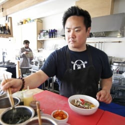 Gary Kim, owner of Anju Noodle Bar in Kittery, creates a portion of shoyu ramen, consisting of meat bone broth, spicy soy tare, slow-roasted pork shoulder, ajitama soy egg and nori.