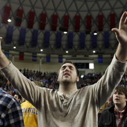 Logan Chambers, from Port Tobacco, Md., prays during a 2013 convocation at Liberty University in Lynchburg, Va., the small Baptist college that television preacher Jerry Falwell founded in 1971. Falwell and his Moral Majority organization were credited in part with President Reagan's election in 1980, having registered millions of evangelicals to vote.