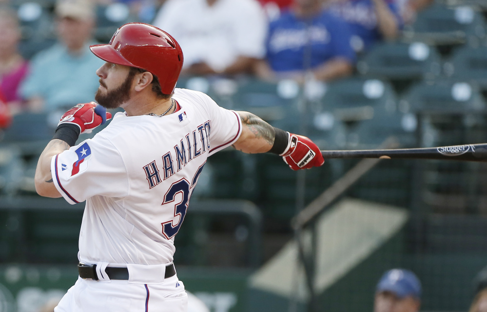 The Texas Rangers' Josh Hamilton hits a solo home run during the second inning Friday night against the Red Sox, who have won just one of five games on their current road trip. Hamilton hit another home run in the fourth inning.