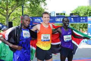 In this photo provided by the New York Road Runners, the first three finishers in the men's division of the UAE Healthy Kidney 10k pose for a photo in New York City's Central Park on Saturday. From left are, Kenya's Geoffrey Mutai, third place; American Ben True, first place; and Kenya's Stephen Sambu, second place.