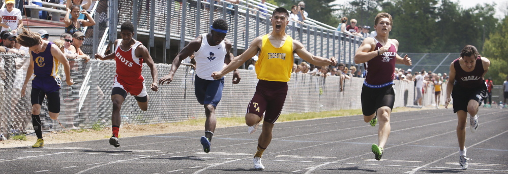 Derek Boissonault of Thornton Academy crosses the finish line Saturday to win the 100-meter dash, just ahead of Cam Johnson of Noble, in the SMAA outdoor track championships at North Berwick. The Thornton boys won the team title for the first time in 29 years. The girls' team for the Trojans also captured a title.