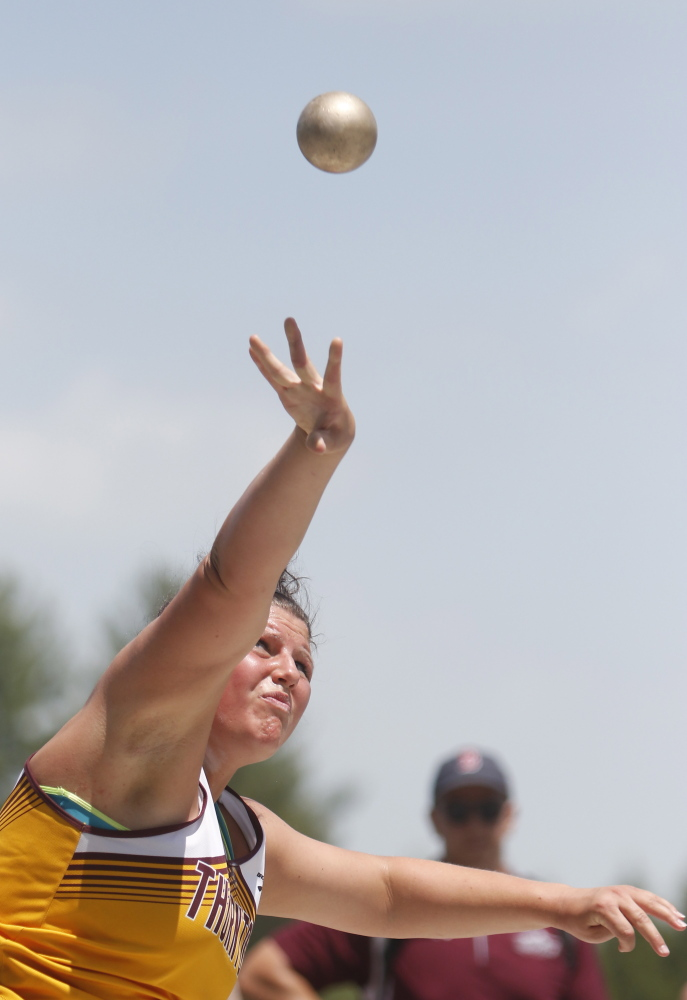 Victoria Lux  of Thornton Academy tosses the shot put during the Trojans' dominating performance at the meet. The state championships will be next Saturday at Mt. Ararat High in Topsham.