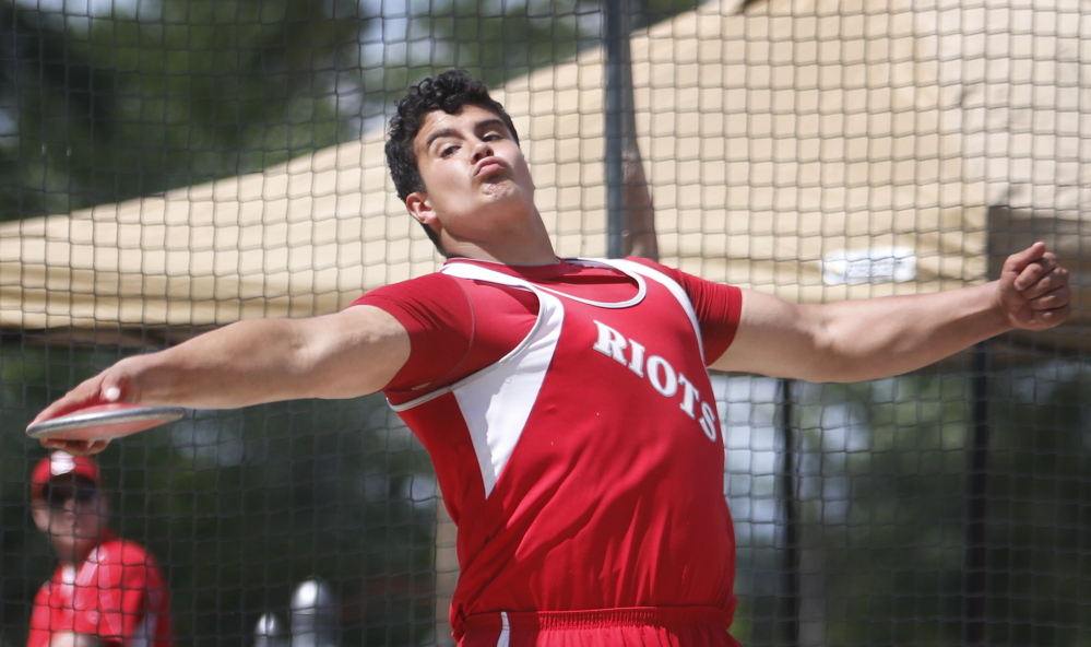Dan Guiliani, who set a meet record in the shot put, beating the old record by more than 6 feet, also captured the discus with a throw of 163 feet, 6 inches.