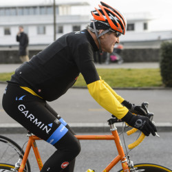 In this March 16, 2015 file picture  U.S. Secretary of State John Kerry, rides a bike after a bilateral meeting with the  Iranian Foreign Minister  in Lausanne, Switzerland.