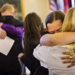 Gabrielle LeDue, 21. of Westbrook, and Abby LeBlanc, 20, of Westbrook embrace while mourning at the wake of their friend Treyjon Arsenault at the Jones, Rich and Hutchins Funeral Home in Portland on Sunday. Arsenault was shot and killed during an altercation in Portland early last week. Photos by Carl D. Walsh/Staff Photographer