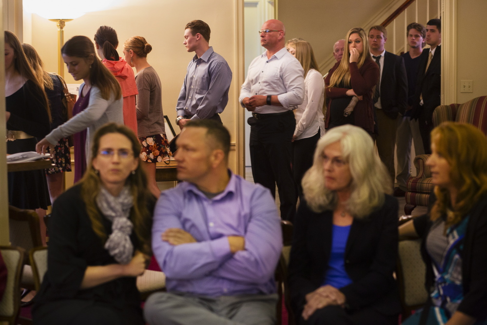 Mourners pay their respects inside the funeral home.