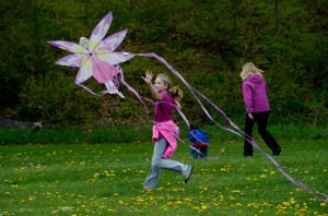 Grace Paiement, 9, of Windham reaches to catch a kite as it lands at Fort Williams in Cape Elizabeth. Paiement was visiting the area with her mother Rita, Aunt Karen Soule of Braselton, Georgia, and her cousin Neo Dang, 5, also of Geoargia.