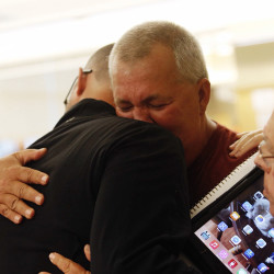 Dennis Munroe of Biddeford hugs Matt Lauzon after he spoke Thursday night at a special City Council meeting focused on allegations of sexual abuse by former Biddeford police officers. Lauzon went public on social media three months ago with his accusations of being abused more than a decade ago. Derek Davis/Staff Photographer