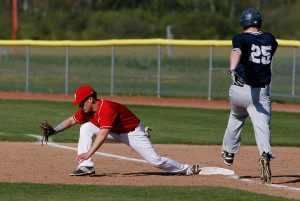 South Portland High's Anthony Degifico stretches to make a play at first base against Portland High's Joe Fusco during the forth inning.