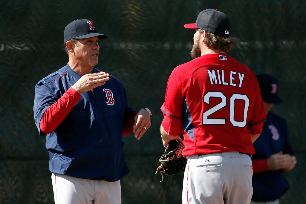 Boston Red Sox pitching coach Juan Nieves, left, was fired Thursday.
