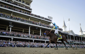 Victor Espinoza rides American Pharoah to victory in the 141st running of the Kentucky Derby horse race at Churchill Downs Saturday. The Associated Press