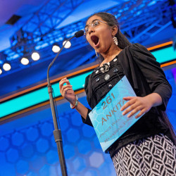 "MAY 28: Ankita Vadiala, 13, of Manassas, Virginia, reacts as she is given the word ""billable"" to spell during the semifinals of the Scripps National Spelling Bee in Oxon Hill, Maryland. Although Vadiala spelled the word correctly, she was eliminated in a later round and Vanya Shivashankar, 13, of Olathe, Kansas, and Gokul Venkatachalam, 14, of St. Louis, were declared this year's co-champions."