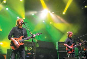 Trey Anastasio on guitar, left, and Mike Gordon on bass play in 2010 during a Phish concert at the Augusta Civc Center. In recent years, the civic center has had trouble bringing big concerts to the city. File Photo/Kennebec Journal