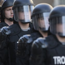 Riot police stand in formation May 23, as a protest forms against the acquittal of Michael Brelo, a patrolman charged in the shooting deaths of two unarmed suspects in Cleveland.  The Associated Press