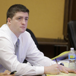 Cleveland police Officer Michael Brelo listens to testimony during his trial in Cleveland. He has been found not guilty in the shooting deaths of two unarmed suspects in a 137-shot barrage of police gunfire after a high-speed chase. The Associated Press