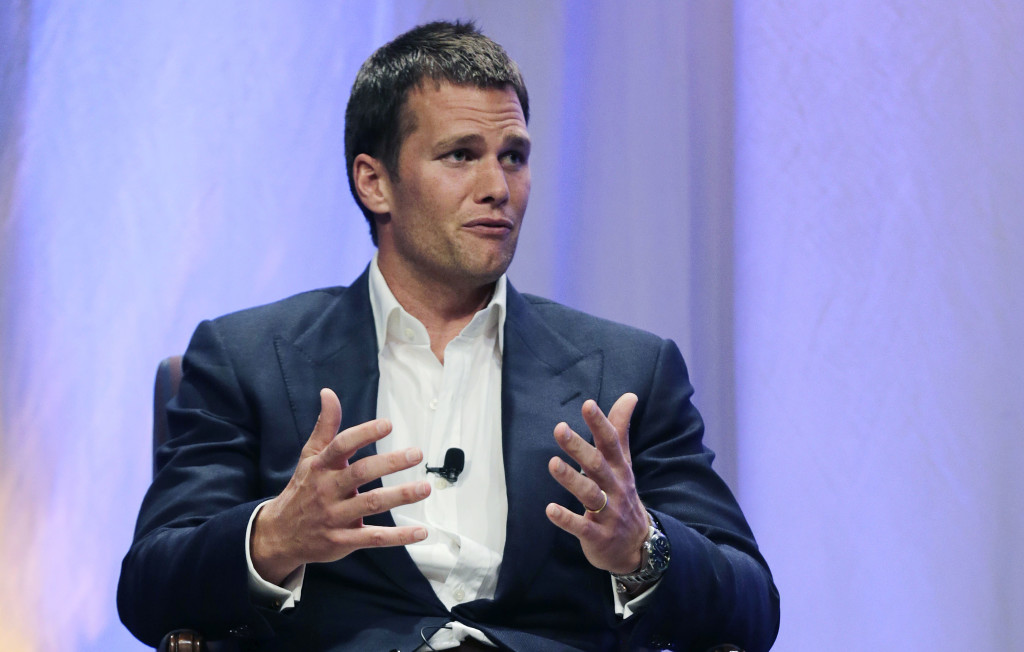 Patriots quarterback Tom Brady speaks during an interview with sportscaster Jim Gray on Thursday night at Salem State University in Massachusetts. Brady gave no direct response to Gray's questions about an NFL investigation's findings that Patriots employees likely deflated footballs and that Brady was