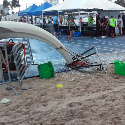 Glass is scattered around a toppled basketball hoop after a waterspout made landfall at a Fort Lauderdale beach. Authorities say three children were injured when the waterspout uprooted a bounce house and sent it across a parking lot into the road.  Burt Osteen via AP