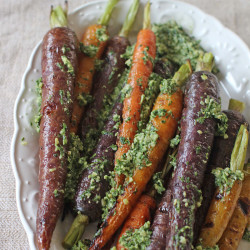 Grilled carrots with carrot top pesto. The Associated Press