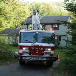 No one was injured in a fire at 12 Brookside Drive in Falmouth on Sunday. Scott Dolan photo