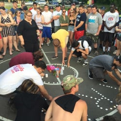 The crowd at Tuesday night's vigil lit candles on a public basketball court off Main Street in downtown Westbrook, where Treyjon Arsenault was a regular. Scott Dolan/Staff Writer