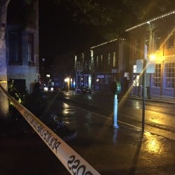 Looking down Market Street toward Fore Street in Portland, police activity appears to be concentrated near Pat's Pizza or an adjacent building. Matt Byrne photo