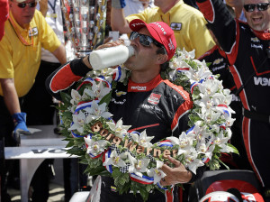 Juan Pablo Montoya, of Colombia, celebrates after winning the 99th running of the Indianapolis 500 auto race at Indianapolis Motor Speedway in Indianapolis, Sunday. The Associated Press
