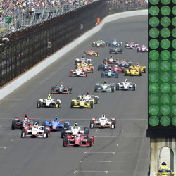 Scott Dixon, of New Zealand, leads the field to start the 99th running of the Indianapolis 500 auto race at Indianapolis Motor Speedway in Indianapolis, Sunday. The Associated Press