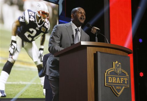 Former New England Patriots cornerback Ty Law announces the Patriots' selection of  Stanford's Jordan Richards as the 64th pick in the second round of the 2015 NFL Football Draft on Friday in Chicago. The Associated Press