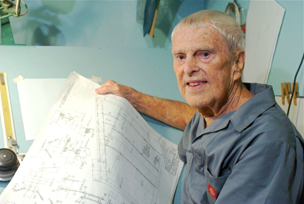 "Oscar Carl Holderer, one of Wernher von Braun's original ""Operation Paperclip"" team members, holds some technical drawings at his home shop in Huntsville, Alabama. Photo by Eric Schultz/AL.com via The Associated Press"