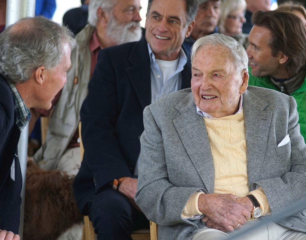 David Rockefeller, right, greets family and friends at a ceremony Friday in Mount Desert marking his gift of 1,000 acres of woodlands, streams, hiking trails and carriage roads abutting Acadia National Park.