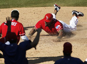 Rangers designated hitter Prince Fielder slides into home for the winning run in the ninth inning. The Associated Press