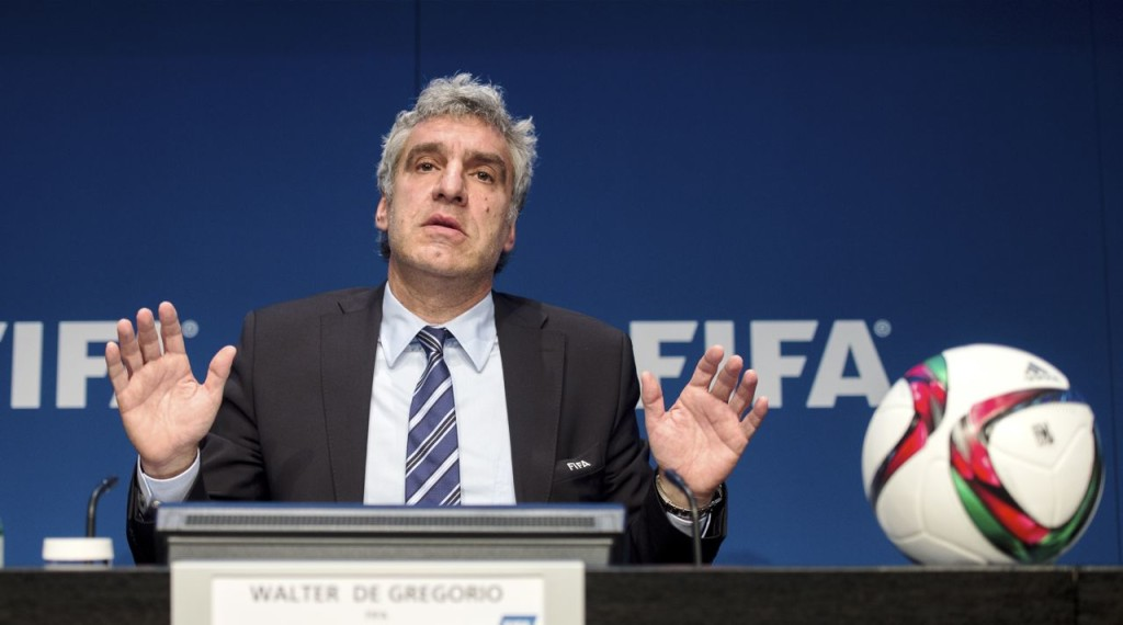 Walter De Gregorio, FIFA director of communications and public affairs, addresses the media during a press conference at the FIFA headquarters in Zurich, Switzerland, Wednesday, May 27, 2015. Swiss federal prosecutors opened criminal proceedings related to the awarding of the 2018 and 2022 World Cups, throwing FIFA deeper into crisis only hours after seven soccer officials were arrested and 14 indicted Wednesday in a separate U.S. corruption probe.(Ennio Leanza/Keystone via AP
