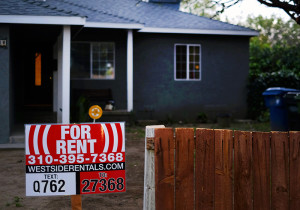 A sign advertises a house for rent in Los Angeles. More than one-in-four renters must devote at least half of their family income to housing and utilities, according to a new analysis of Census data by Enterprise Community Partners, a nonprofit that helps finance affordable housing.  The Associated Press