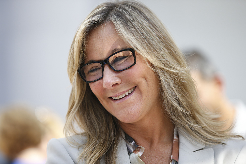 Angela Ahrendts, senior vice president of retail and online stores at Apple Inc., appears at a publicity event in Palo Alto, California, for the  launch of the new iPhone 6 in this Sept 19, 2014, photo.