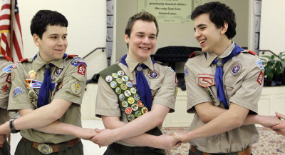 Pascal Tessier, center, takes part in an activity with fellow scouts Matthew Huerta, left, and Michael Fine, right, after he received his Eagle Scout badge in Chevy Chase, Md., in February 2014. Last month, the Boy Scouts' New York chapter announced it hired Tessier, the nation's first openly gay Eagle Scout, as a summer camp leader, in defiance of the national scouting organization's ban on openly gay adult members.