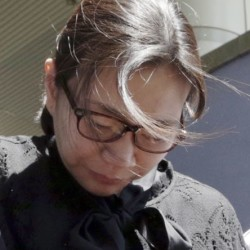 Cho Hyun-ah, who is the daughter of Korean Air's chairman, leaves Seoul High Court Friday. The Associated Press