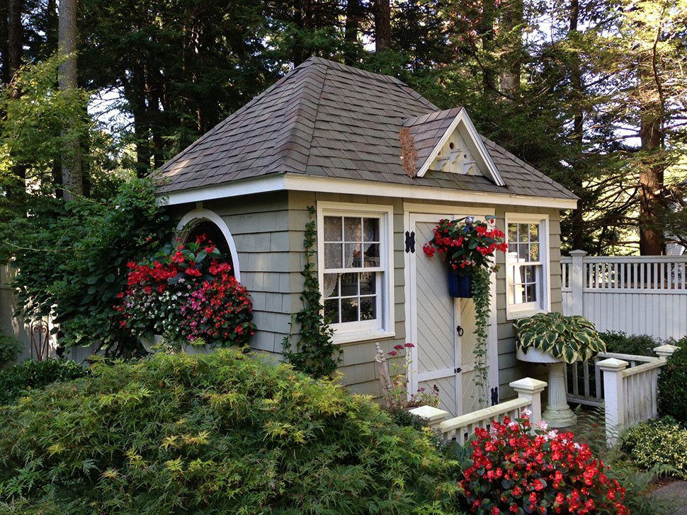 Little 39 houses 39 enhance garden 39 s charm the portland for Garden shed homes
