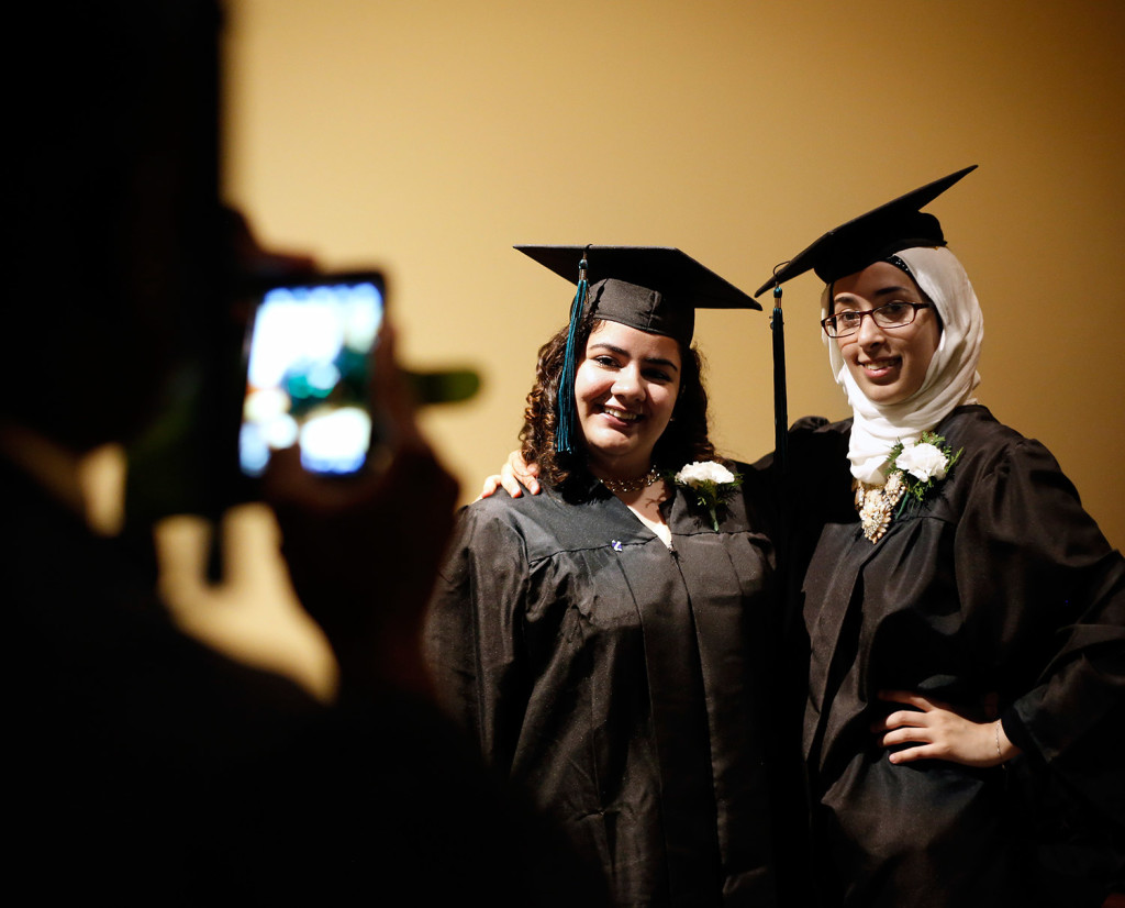 Mina Mohammed, left, and Noor Ibrahim pose for a photograph before the Casco Bay High School graduation ceremony Thursday evening at the Merrill Auditorium.