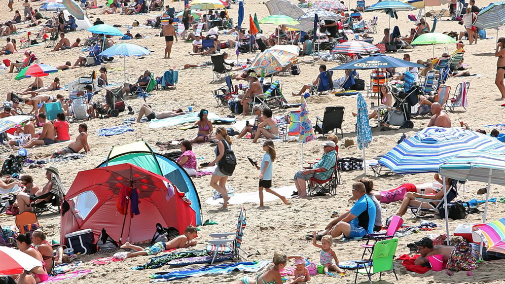 Visitors crowd the sand at Old Orchard Beach in this 2014 Press Herald file photo. The type of summer weather pattern that makes it hotter than normal in the eastern U.S. used to happen about 18 days a summer in the early 1980s. It now occurs about 26 days a summer, the study found.