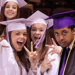 Meghan Connolly, Kayla Baldwin, Terry Bell, left to right in front, and Nicole Labbe, rear, strike a pose while waiting for Deering High School's graduation to start at the Cross Insurance Arena in Portland on Wednesday.