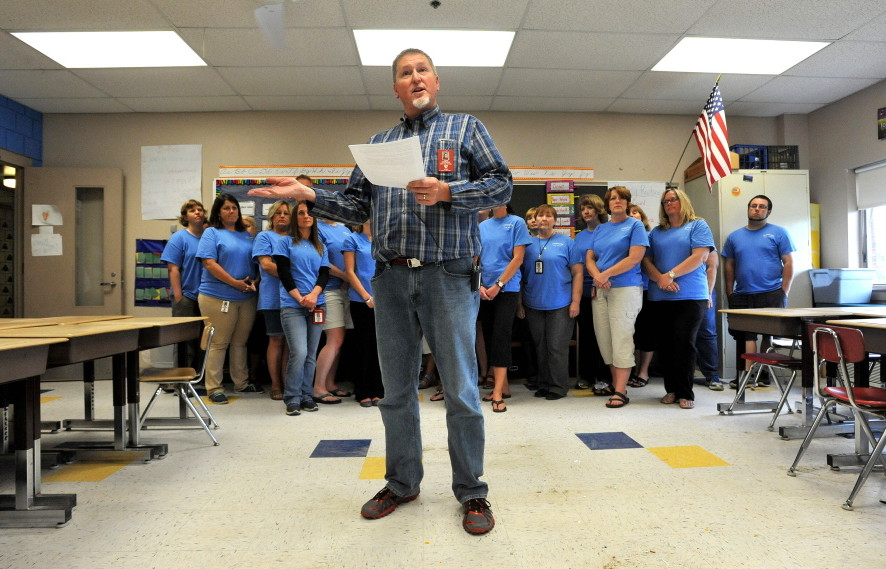 Jeff DeJongh, president of the Augusta Education Association, reads a statement during a news conference Tuesday at Farrington Elementary School in Augusta to address allegations that teachers at the school left posters on a wall that offered assistance to students during standardized testing.
