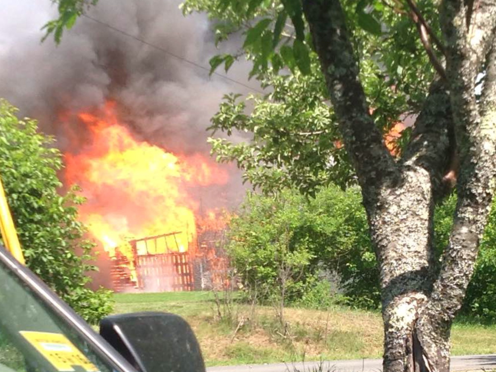 A Saturday fire at a Newport barn was believed to have been started by a smoke bomb for pest control, fire officials said.
