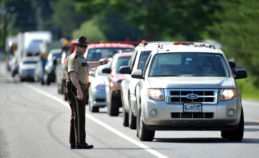 Traffic backs up Friday on Route 139 in Norridgwock at the scene of a three-vehicle collision that injured two drivers.