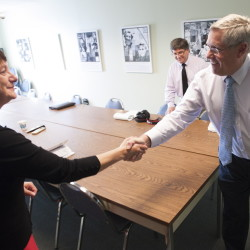 Interim UMA president Rebecca Wyke is welcomed by Chief Business Officer Tim Brokaw at the start of her first executive committee meeting on Monday.
