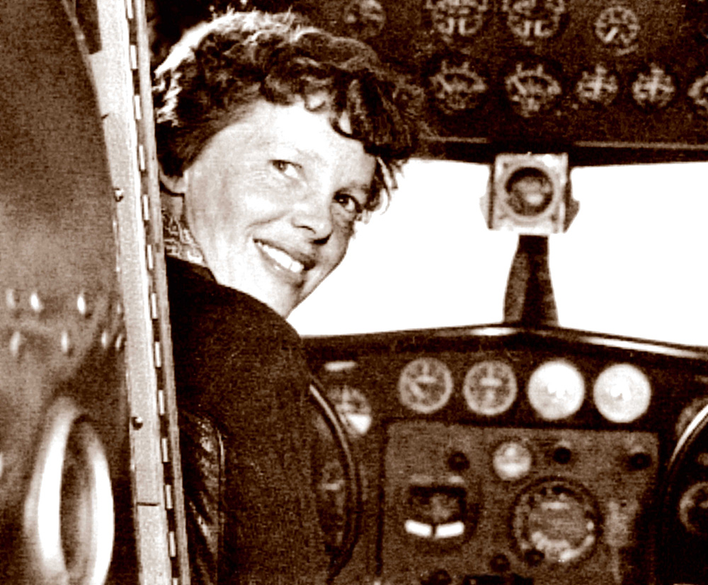 Amelia Earhart poses in the cabin of her Electra plane in this In this May 20, 1937, photo taken by Albert Bresnik at Burbank Airport in Southern California. The Paragon Agency via AP)